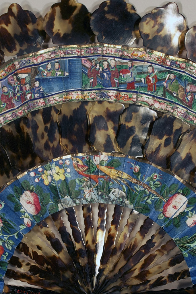 """""""Thousand faces"""" fan, detail,  Chinese, ca. 1850  Two painted paper leaves with applied ivory faces and silk robes and tortoise shell sticks and guards.  Gift of Dr. Lotar and Luanna Stahlecker, KSUM 2004.31.69"""