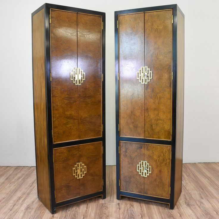 "This pair of ""Century"" asian inspired armoires are featured in a solid wood with a glossy burl wood front and black lacquer trim. These tall skinny wardrobes are in great condition with 3 drawers, shelf space and gold hardware. Unique storage pieces! #asian #dressers #armoireorwardrobe #sandiegovintage #vintagefurniture"