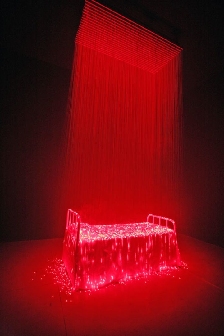 Based in Beijing, artist Li Hui uses modern technology, lights, lasers, and LED lights to create fantastic, illuminated displays. In Reincarnation, the Chinese artist used fog, metal, medical bandages, and bright red laser lights streaming down from the ceiling to light up an everyday bed frame underneath.