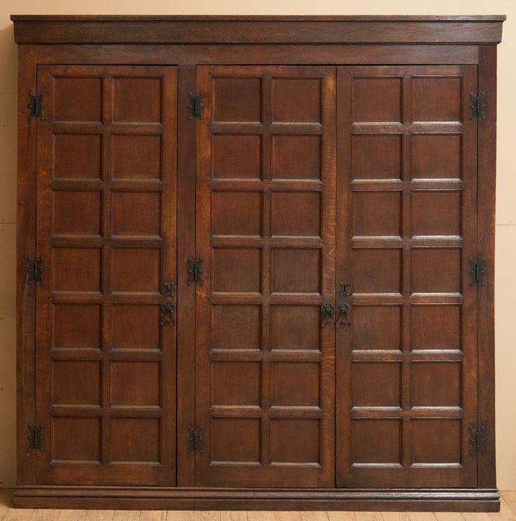 ENGLISH ARTS AND CRAFTS CARVED OAK THREE-DOOR CUPBOARD - Price Estimate: $800 - $1200