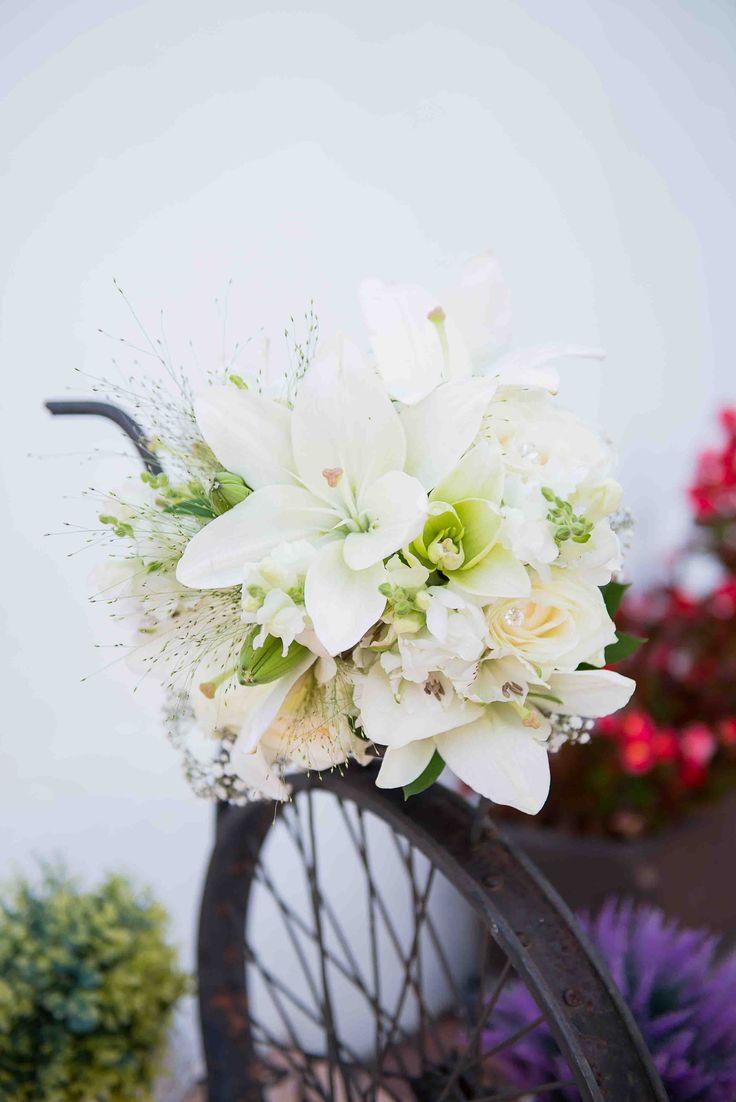Cream lilium, fountain grass, white rose and lisianthus bouquet