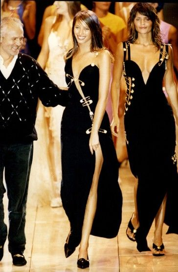 One of the original supermodels, Christy was a regular on the Versace catwalk, pictured here alongside thr late Gianni Versace in a safety-pin dress with Helena Christensen in the background.
