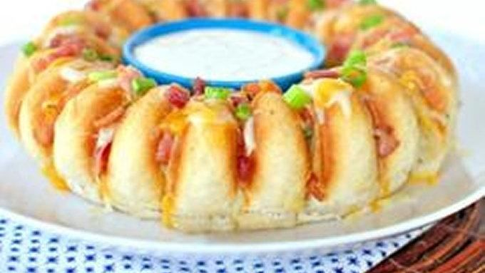 Soft bread is sliced and stuffed with bacon, cheese and green onions for a fun appetizer for any party!