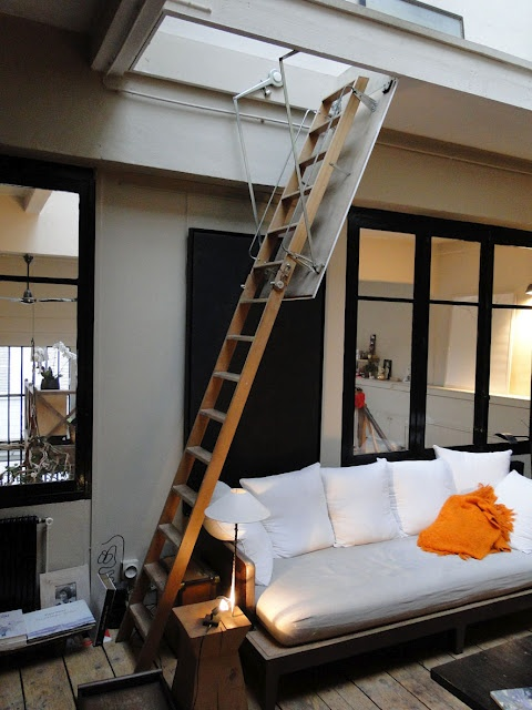 Not a terrible idea, but usually attic stairs are flimsy. So, really a spiral staircase would be interesting and you could still do a hatch opening.