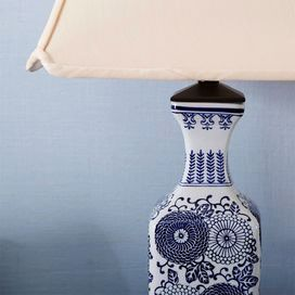 """Gaipen Table Lamp 152.95 from 297-. J & M.  Cast a warm glow in your entryway or den with this Asian-inspired ceramic table lamp, showcasing a flared base and floral motif.   Product: Table lampConstruction Material: Ceramic and fabricColor: Off-white and midnight blueFeatures:  Single detent switchClipped corner square bottom shade Accommodates: (1) CFL bulb - not includedDimensions: 28"""" H x 15"""" W x 15"""" D"""