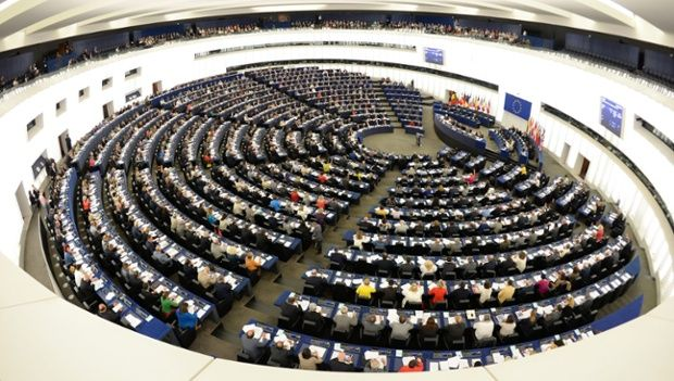 Members of the European Parliament vote during a plenary session at the European Parliament in Strasbourg, France.