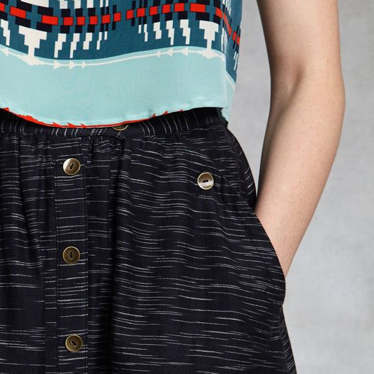 """www.zady.com  Since 1863 Pendleton has been a beacon of quality American manufacturing. For Pendleton The Portland Collection, the design is in the details. The team charged with reviving Pendleton's USA-made heritage brand made a strong play with texture this season. The contemporary-fitting Navy McKenzie Skirt sits low on the waist. The 29"""" A-line skirt is made of 100% Khadi and is woven and lined in Pendleton-owned American mills. @Zady"""