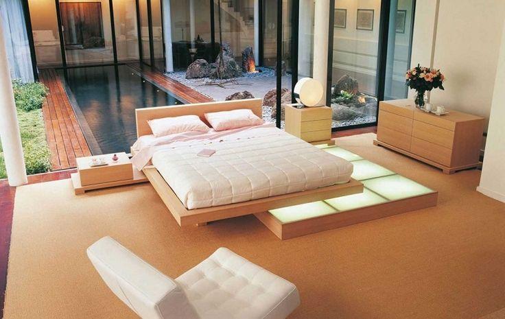 dormitorio al estilo minimalista con sillón blanco