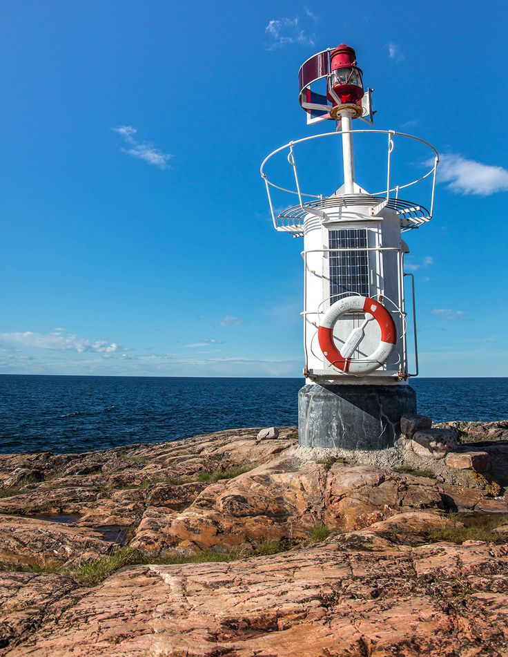 Sikhjalma lighthouse @ shore of the Baltic sea, Uppsala county Sweden