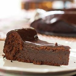 Mexican Flourless Chocolate Cake - Topped with a decadent ganache and with a hint of heat