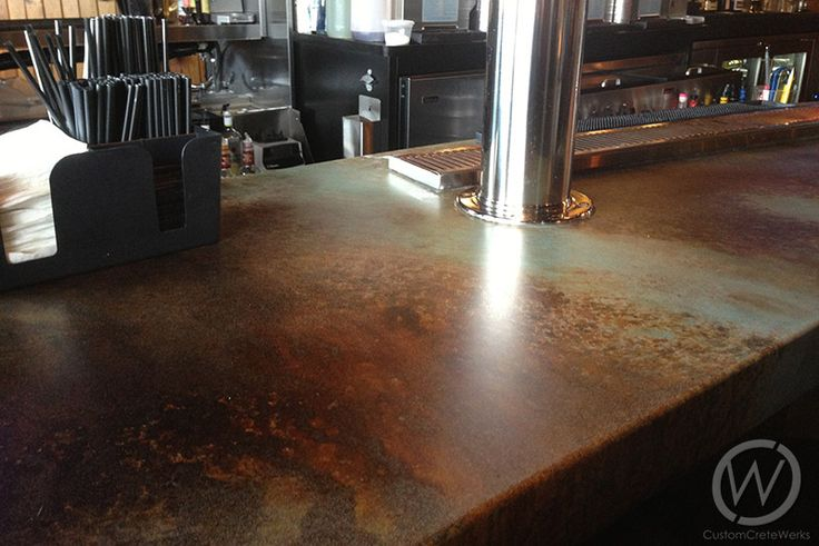 With unlimited design potential, a custom concrete bar adds both personality and value to your home. Tailor-made to complement any decor, #concrete #bar tops enhance the look and feel of contemporary, traditional and rustic homes. This is an example of a acid stained concrete countertops?