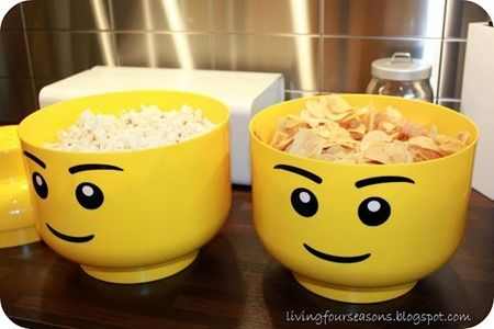 lego snack bowls -Get creative with your serving dishes – these Lego Storage Heads make great chip bowls!