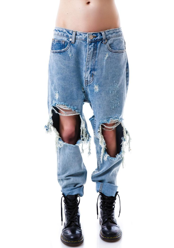 UNIF Twerk Jeans lemme see what yer mama gave ya. These premium 5 pocket high waisted jeans feature some serious sass with their shredded knee and rear details. The waist sits naturally on the waist, while the distressed holes under the back pockets lets ya show off yer assets when ya werk-it and twerk-it. The classic button and zipper fly closure and tapered leg makes these seXXXy BBs a badazz upgrade that Miley would be proud of.