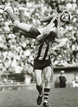 Sydney Swan Warwick Capper takes a characteristic hanger, over Hawthorn's Chris Langford, in 1987.