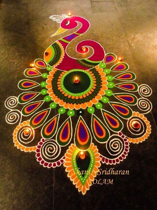 In This Photo You See A Rangoli With The Drawing Of Peacock