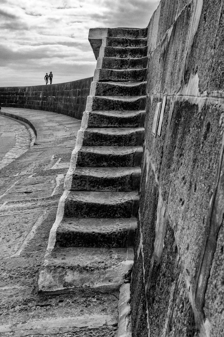 """Walking on The Cob - The famous Cob at Lyme Regis, which has appeared in many films most famous of which is """"The French Lieutenants Woman""""."""