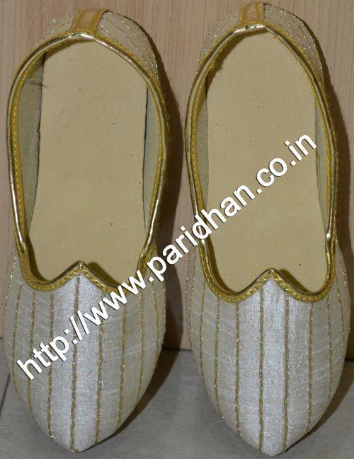 Attractive silk mojari made in cream color silk fabric.