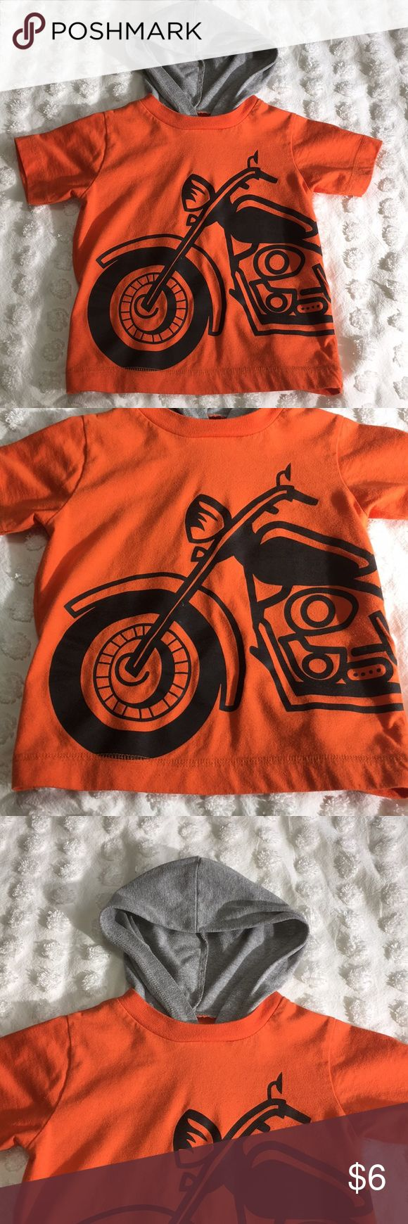 Orange short sleeve motorcycle hooded T-shirt VGUC orange short sleeve T-shirt with black motorcycle graphic on front features grey built in hood. Super cute Shirts & Tops Tees - Short Sleeve