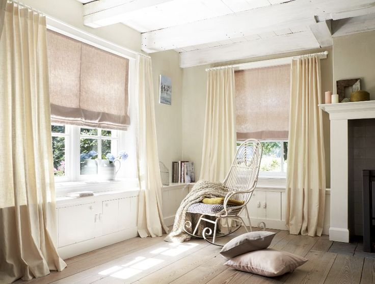 Vadain is a Budget Blinds exclusive in North America! Monochromatic flat roman shades and drapes.