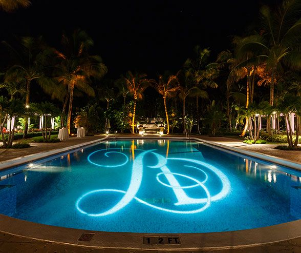 Gobo Lighting Allows The Couples Monogram To Be Showcased In A Beautiful Aqua Pool