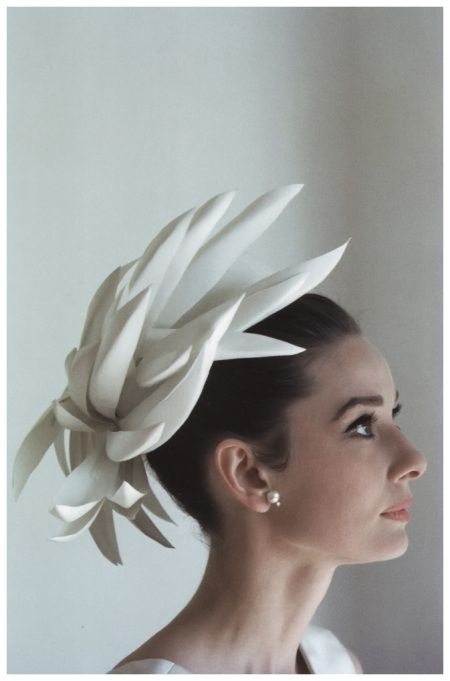 Audrey Hepburn wearing hat and dress designed by Givenchy, photo by Howell Conant (for a fashion editorial) at her house in Switzerland, in February 1962.