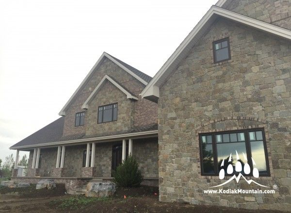 Mountain Blend Tumbled Natural Stone blended with General Shale Carriagehouse Thin Brick