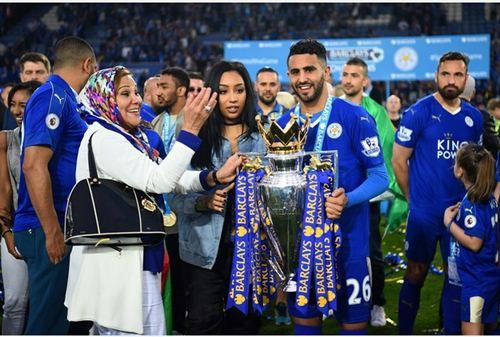 LEICESTER, ENGLAND - MAY 07: Riyad Mahrez of Leicester City poses for photographs with the Premier League Trophy with his family after the Barclays Premier League match between Leicester City and Everton at The King Power Stadium on May 7, 2016 in Leicester, United Kingdom.  (Photo by Shaun Botterill/Getty Images)