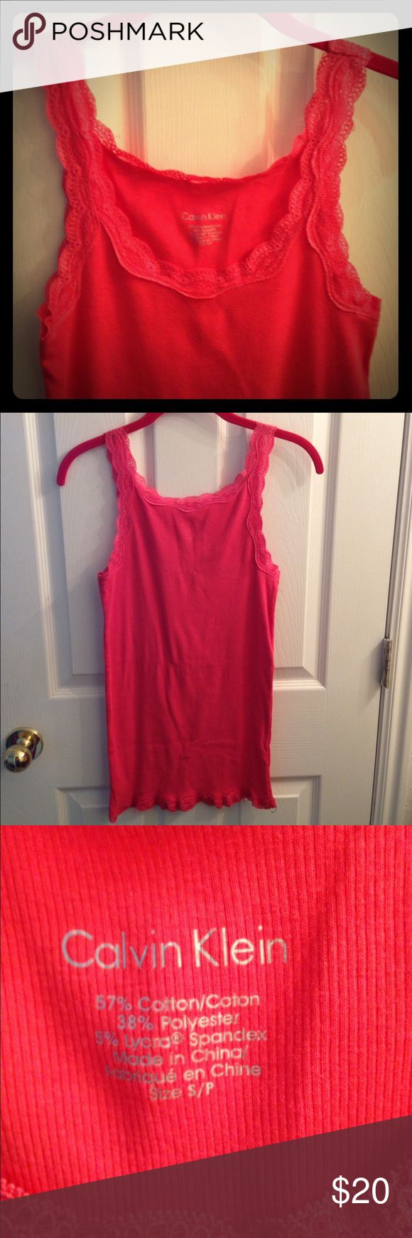 Calvin Klein Lace Tank Top A cute peach color laced tank top. Only worn once. In great condition!!! Calvin Klein Tops Tank Tops