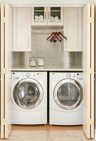 Awesome washer closet. LOVE the tile backsplash.