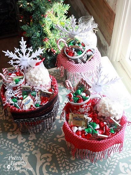 I love making my own gift baskets. They cost less than a store bought version. Plus, they don't need to be wrapped! Make your own warm and cozy gift baskets with hot cocoa, chocolate, a mug and a scarf!