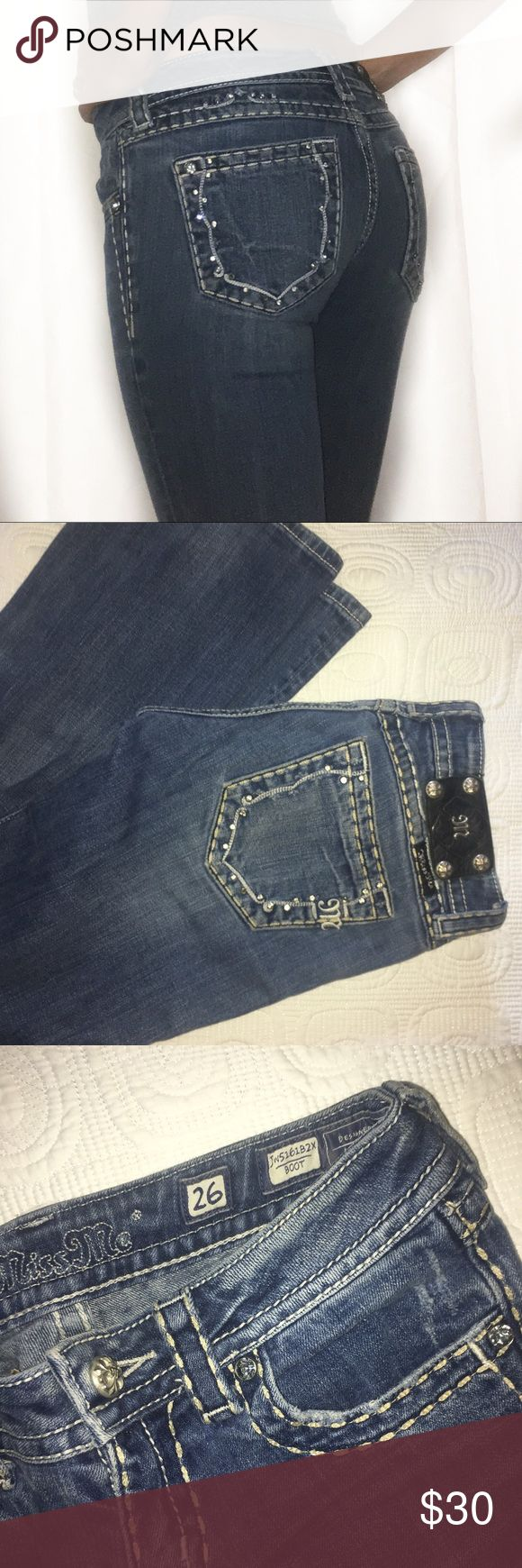 Miss Me jeans Miss Me brand boot cut jeans. Pretty good condition, but can tell hey have been worn. Size 26. Few gems are missing on the back pockets. Miss Me Jeans Boot Cut