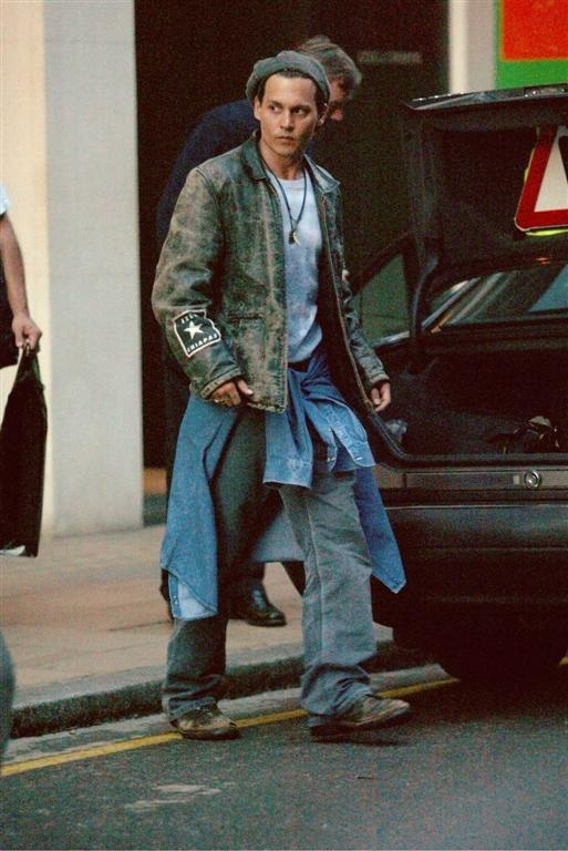 "Johnny Depp looking extremely homeless. But in a cool, ""I can do that because I'm Johnny Depp"" kind of way."
