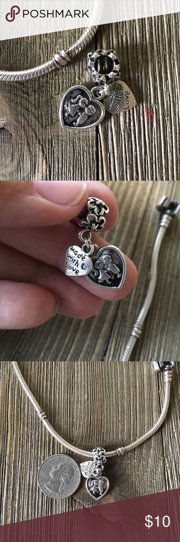 ❤️Made with Love Charm❤️ Stunning silver plated double charm. It has 2 dangling charms with a beautiful True Love meaning! 💫NO BRAND NAME but Fits Pandora style bracelets...picture is of my authentic Pandora bracelet with the charm so you can see how it fits. Quarter for size reference. ❤️PRICE FIRM unless BUNDLED❤️💝💝Buy 1, get one 50% off💝💝 Jewelry Bracelets