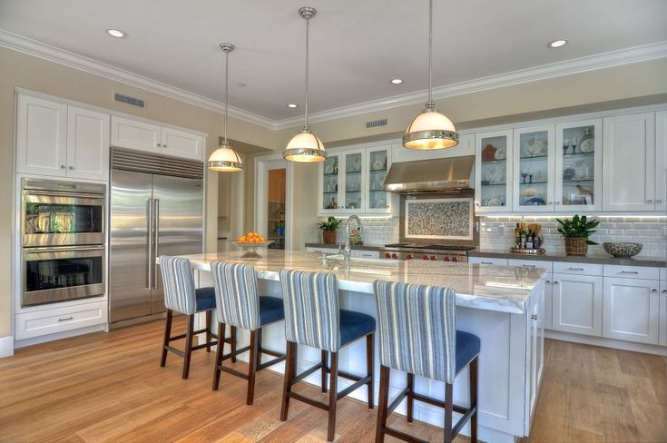 Hottest home design trends for 2014: dark countertops and glass-front cabinets.