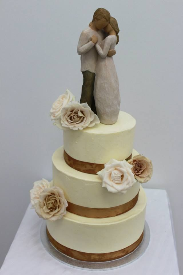 Smooth buttercream with lovely roses and Willow Tree topper