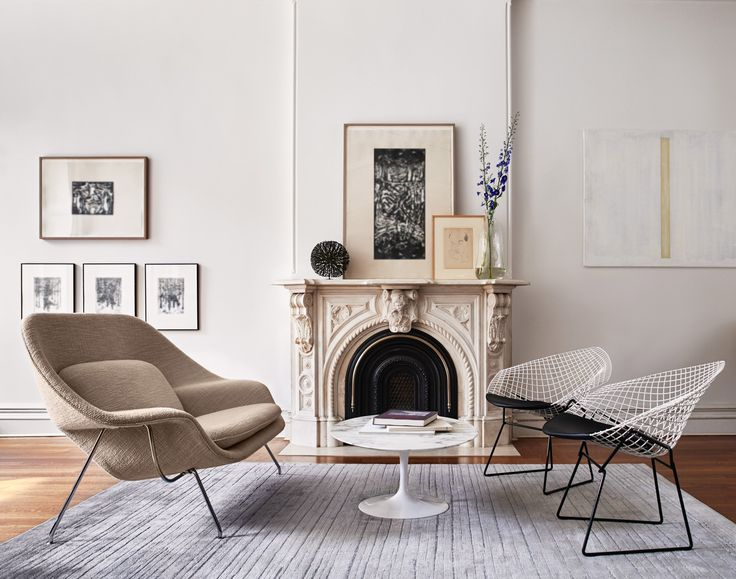 Knoll saarinen womb settee in living room with saarinen pedestal coffee table and black and white bertoia diamond chairs