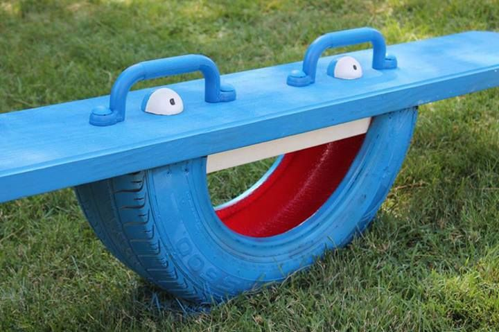 Simple homemade playground ideas from recycled materials such as tires. The eyes are creepy though.