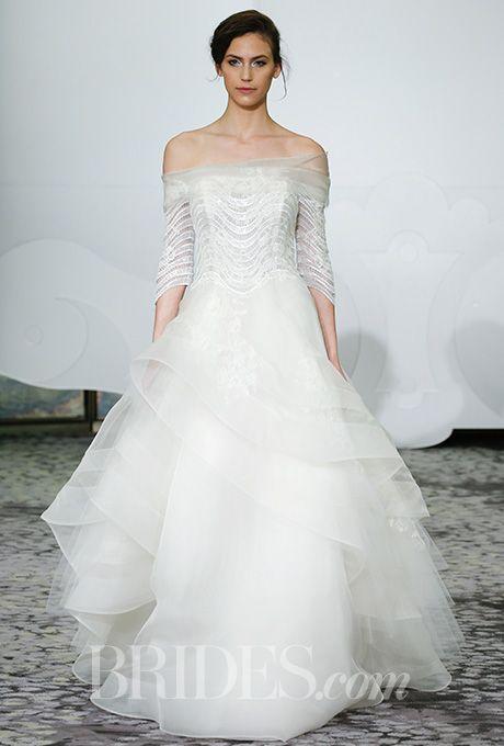 Brides.com: Three-quarter sleeve gown with multilayer organza ball skirt. Rivini by Rita Vinieris Spring 2016.