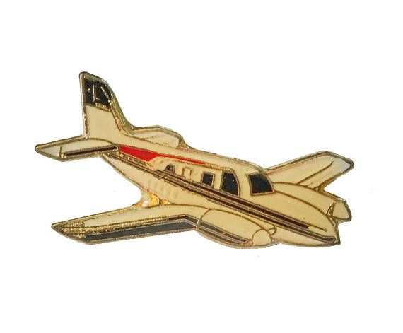"""PRIVATE PLANE vintage enamel pin lapel badge CESSNA Skyhawk Breezer Airplane by VintageTrafficUSA  14.00 USD  A vintage plane pin! Excellent condition. Measures: approx 1"""" 20 years old hard to find vintage high-quality cloisonne lapel/pin. Beautiful die struck metal pin with colored glass enamel filling. Add inspiration to your handbag tie jacket backpack hat or wall. Have some individuality = some flair! -------------------------------------------- SECOND ITEM SHIPS FREE IN USA!!! LOW…"""