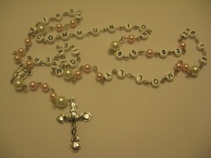 Personalization makes the perfect gift  for Christmas, Mother's Day, Birthdays, Anniversaries, First Communion, a New Baby, Weddings or just because!  $30.  Rosaries can be personalized with names, dates, birthstone colors, so many different ways. Each personalized rosary comes with it's own organza pouch for storage. Personalize your Rosary by choosing your crystal colors, cross style, and connector style by clicking on the rosaries link at www.ninisbeading.com
