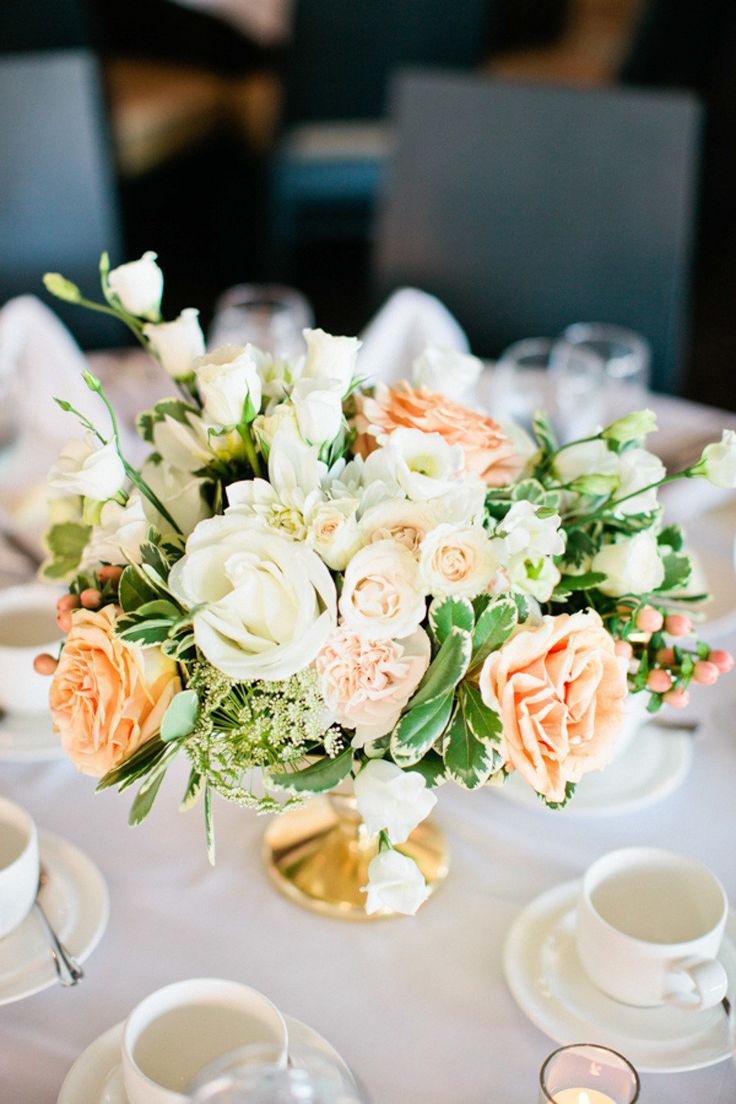 Peach and ivory floral arrangement in a gold pedestal bowl. #wedding #centerpiece #flowers