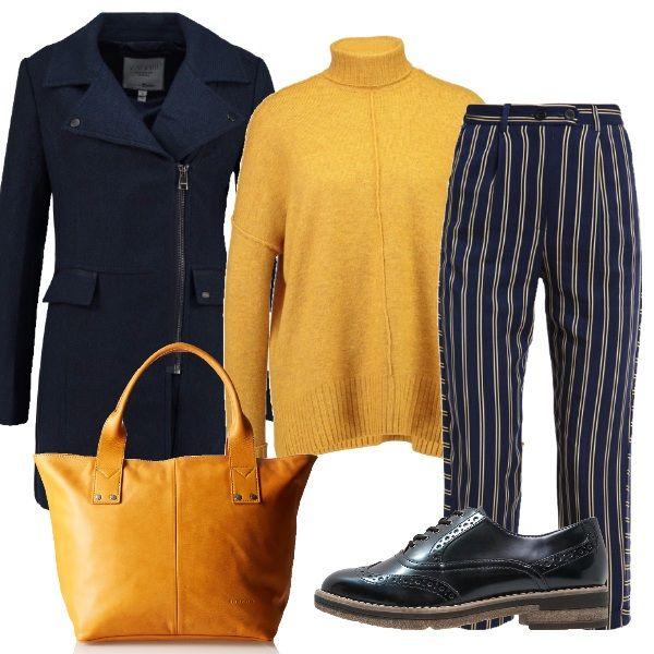 Anche in inverno spesso ci sono delle belle giornate di sole e questo outfit è perfetto per essere indossato in quei giorni. Il look è composto da pantaloni culotte a righe, un maglione giallo, un cappotto e delle stringate blu e una borsa gialla.