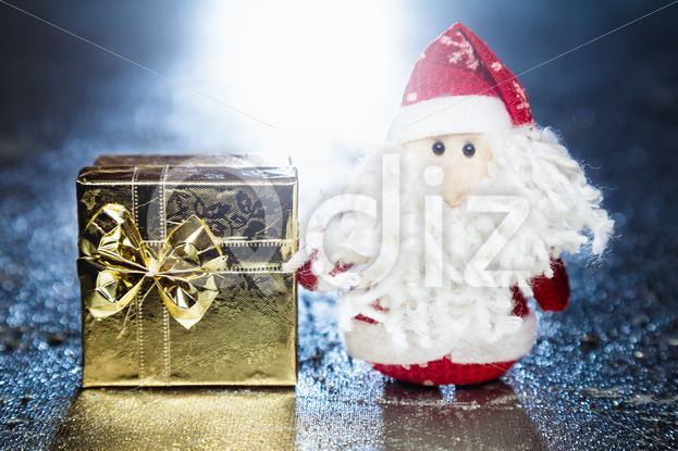 Qdiz Stock Photos | Santa Claus or Father Frost with gift box or present,  #background #beard #beautiful #beauty #blue #bow #box #celebration #Christmas #Claus #Clause #closeup #color #colorful #decoration #decorative #doll #eve #Father #figure #frost #fun #funny #gift #gold #golden #greeting #grunge #holiday #little #Merry #metal #new #object #package #present #red #ribbon #Santa #silver #small #surprise #toy #traditional #white #xmas #year #yellow