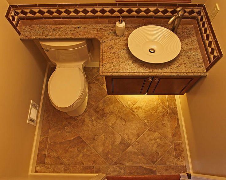 Woodbridge Montclair powder bathroom remodel  Like: counter space extends over toilet back
