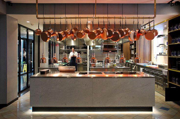 Concrete and copper open kitchen at the Pressroom Restaurant