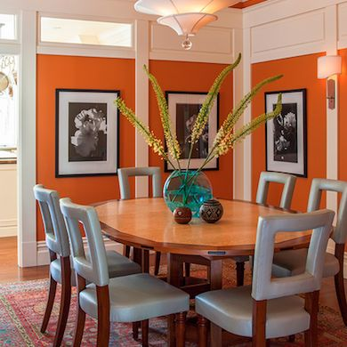Bright Orange Dining Room with Cut-out Back Chairs