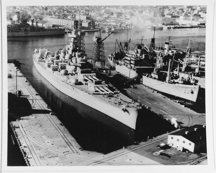 """USS Massachusetts (BB-59) laid up at the Norfolk Naval Shipyard, Virginia, on 3 January 1963. At that time she had been stricken from the Naval Vessel Register, but was awaiting preservation as a memorial. USS Uvalde (APA-88) is at right."" (NHHC: NH 72672)"
