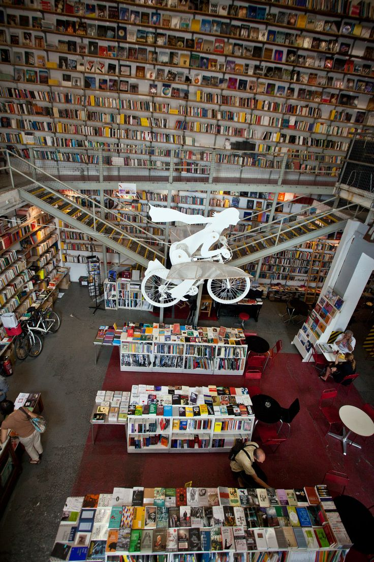 How cool are the slanted shelves? Love how unique this #bookstore looks!