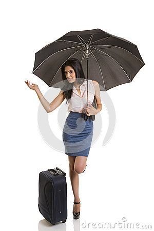 Traveling pretty business woman holding opened black umbrella and checking for rain.  on white.