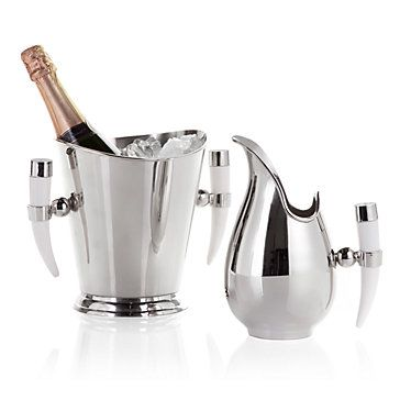 Your bar will be stylin' with the addition of our fabulous shiny nickel plated champagne bucket and pitcher. $59.95